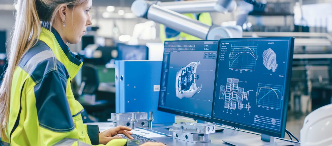 At the Factory: Female Mechanical Engineer Designs 3D Engine on Her Personal Computer, Male Automation Engineer Uses Laptop for Programming Robotic Arm.